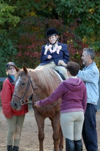 Chelsi being led on a horse
